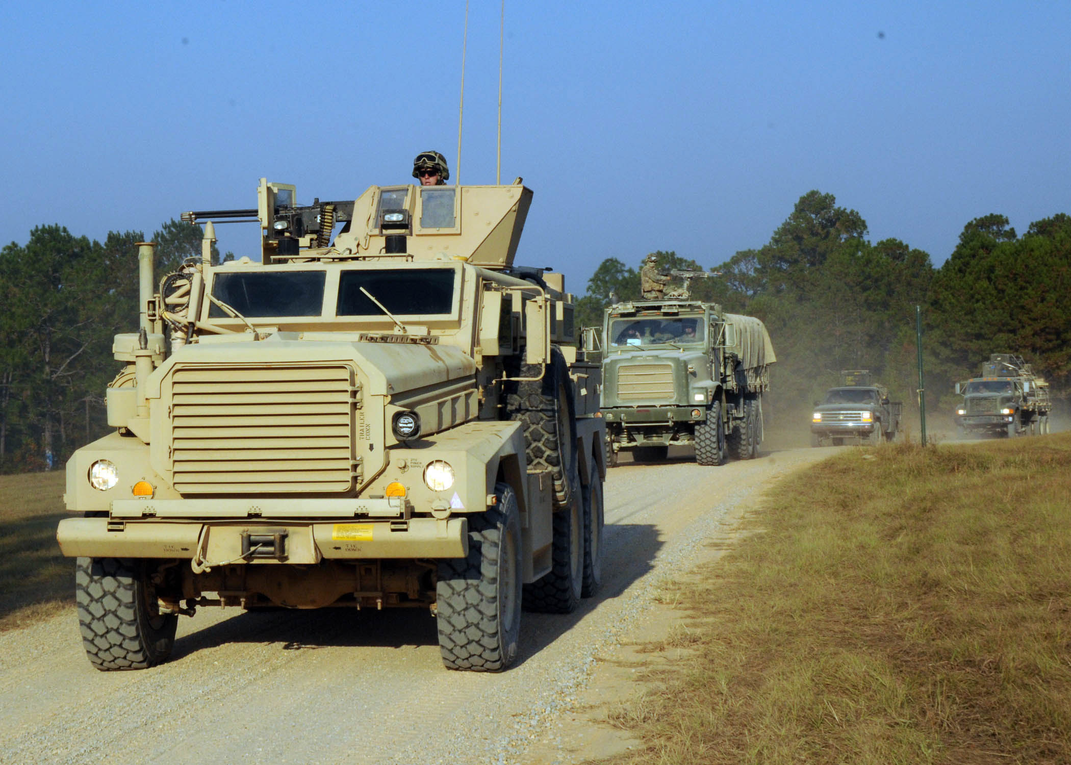 detail of Naval Mobile Construction Battalion (NMCB) 74 arrive at their camp site. NMCB-74 is conducting a field training exercise before deploying later this