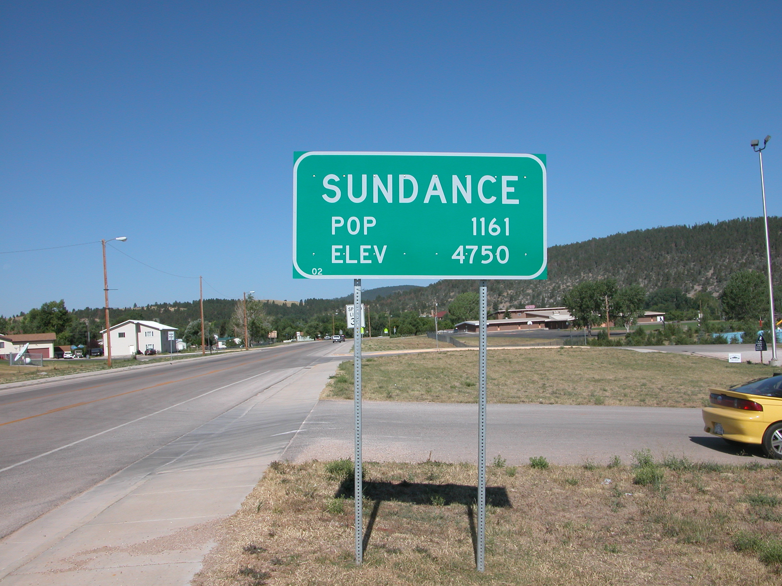 2003-08-16_Sundance,_Wyoming_city_limit_sign.jpg