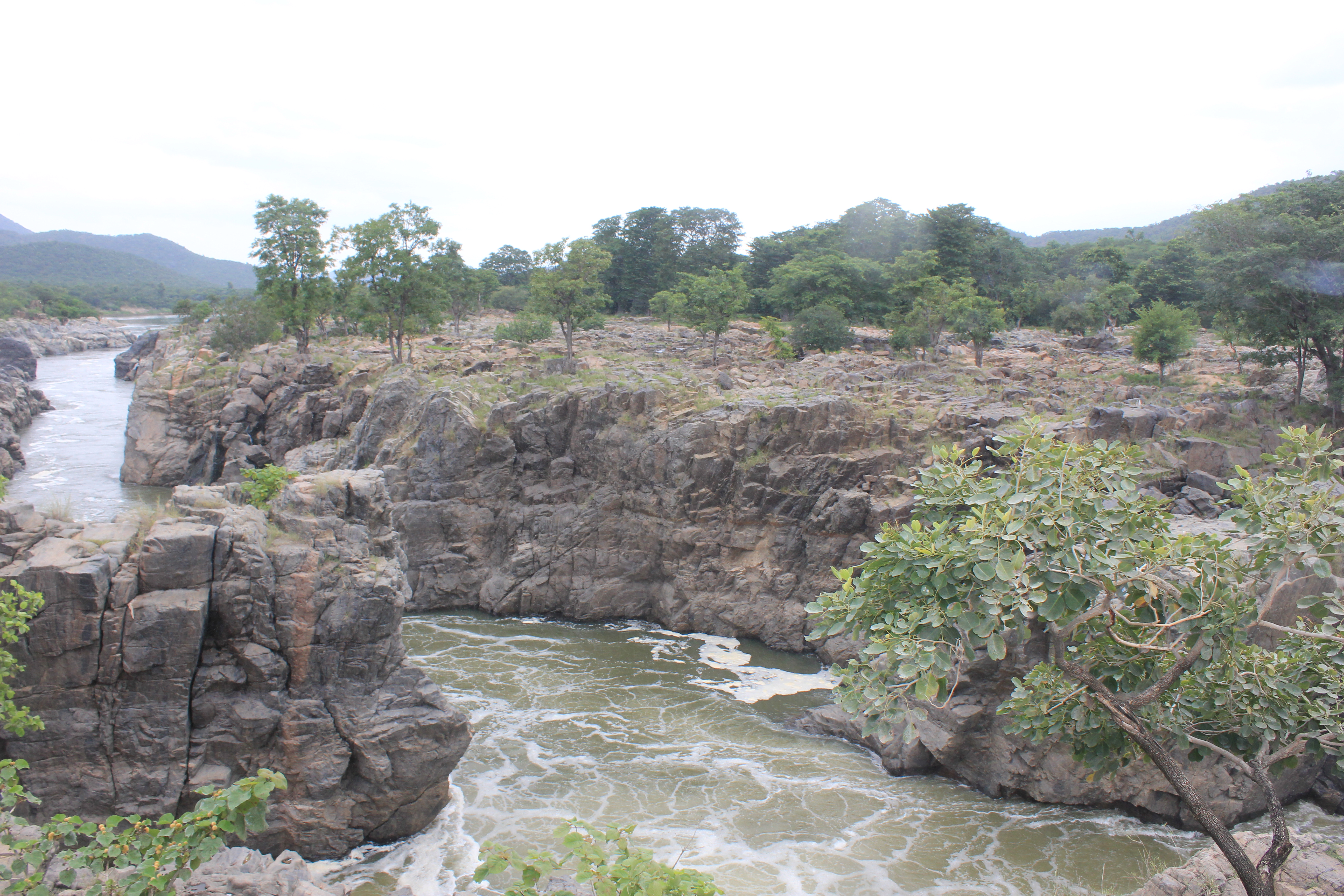 File Cauvery River Water Flowing Amidst Rocky Hills