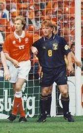 Stuart McCall (in blue), pictured playing for Scotland against The Netherlands during UEFA Euro 1996 Mccall scotland.jpg