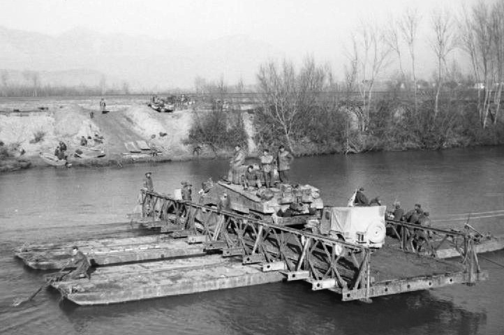 A Sherman tank rafted across the Garigliano River