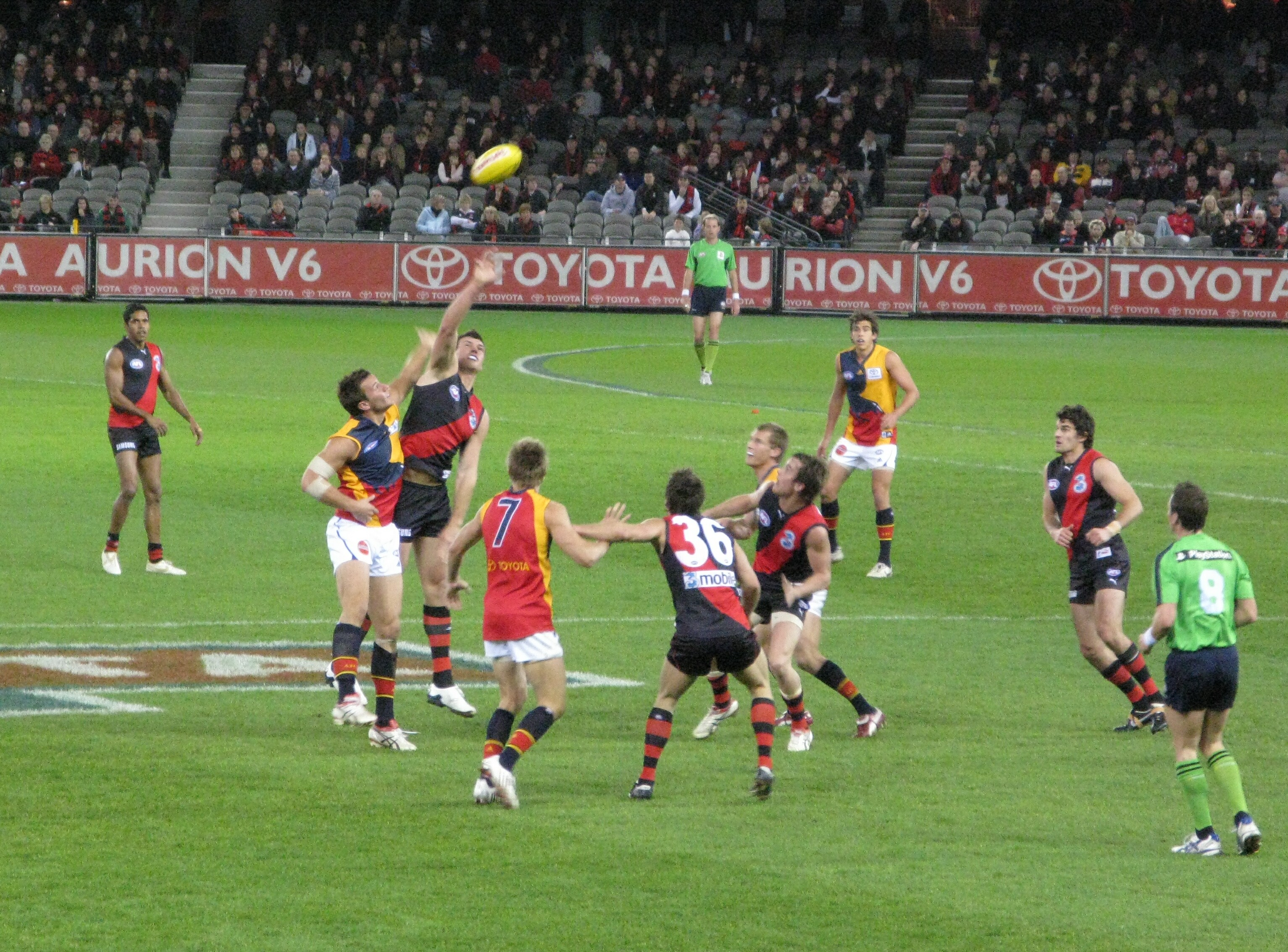Description afl match between essendon (red and black) and adelaide