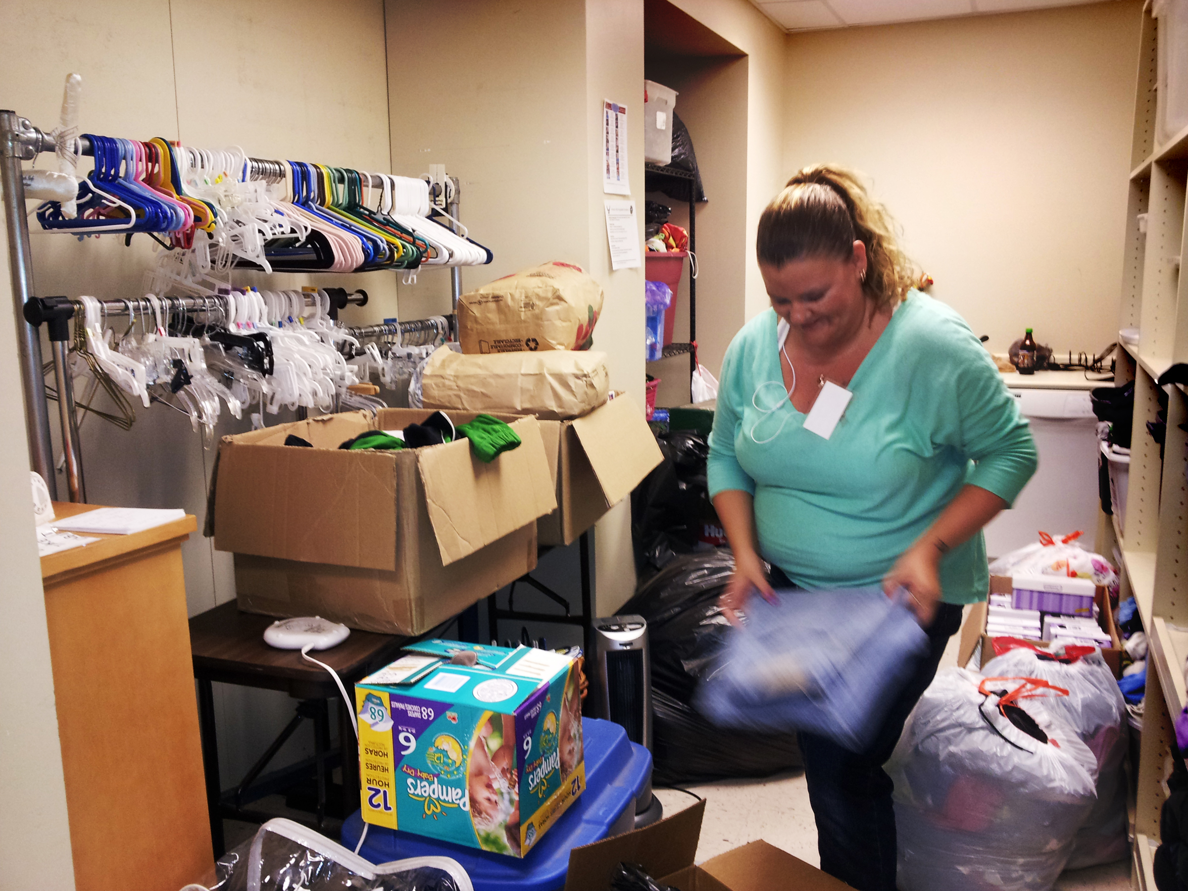 FileAndrea Collins sorts and folds donations in the Airmanu0027s Attic at Tinker Air Force & File:Andrea Collins sorts and folds donations in the Airmanu0027s Attic ...