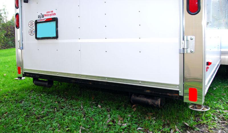Enclosed Car Trailer Traveling In Packs