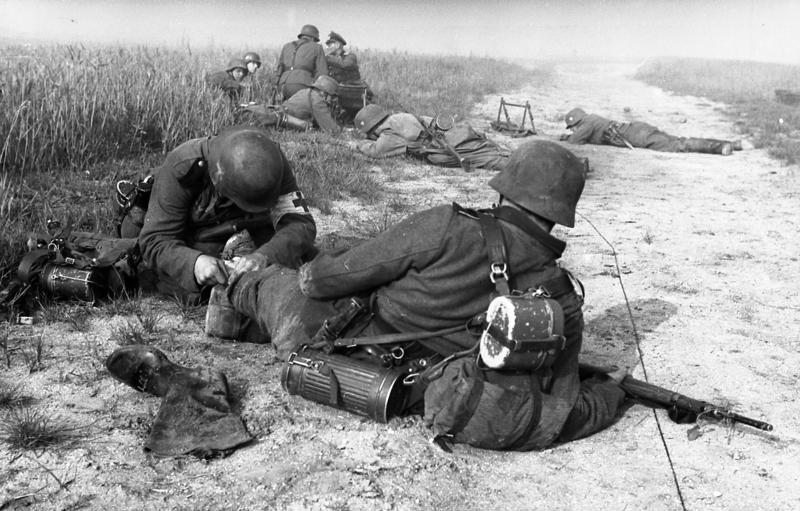 A German medic gives first aid to an injured soldier