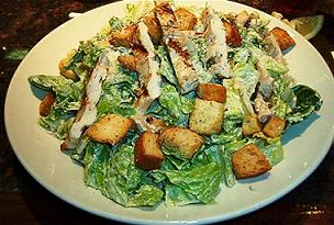 A Caesar salad variation topped with grilled chicken.