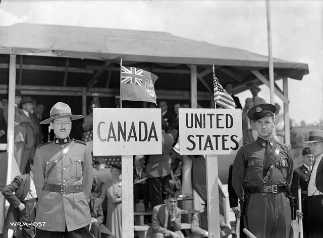 A Canadian Mounted Police and State Trooper stand in ceremony to commemorate the joining of a pipeline between Portland and Montreal