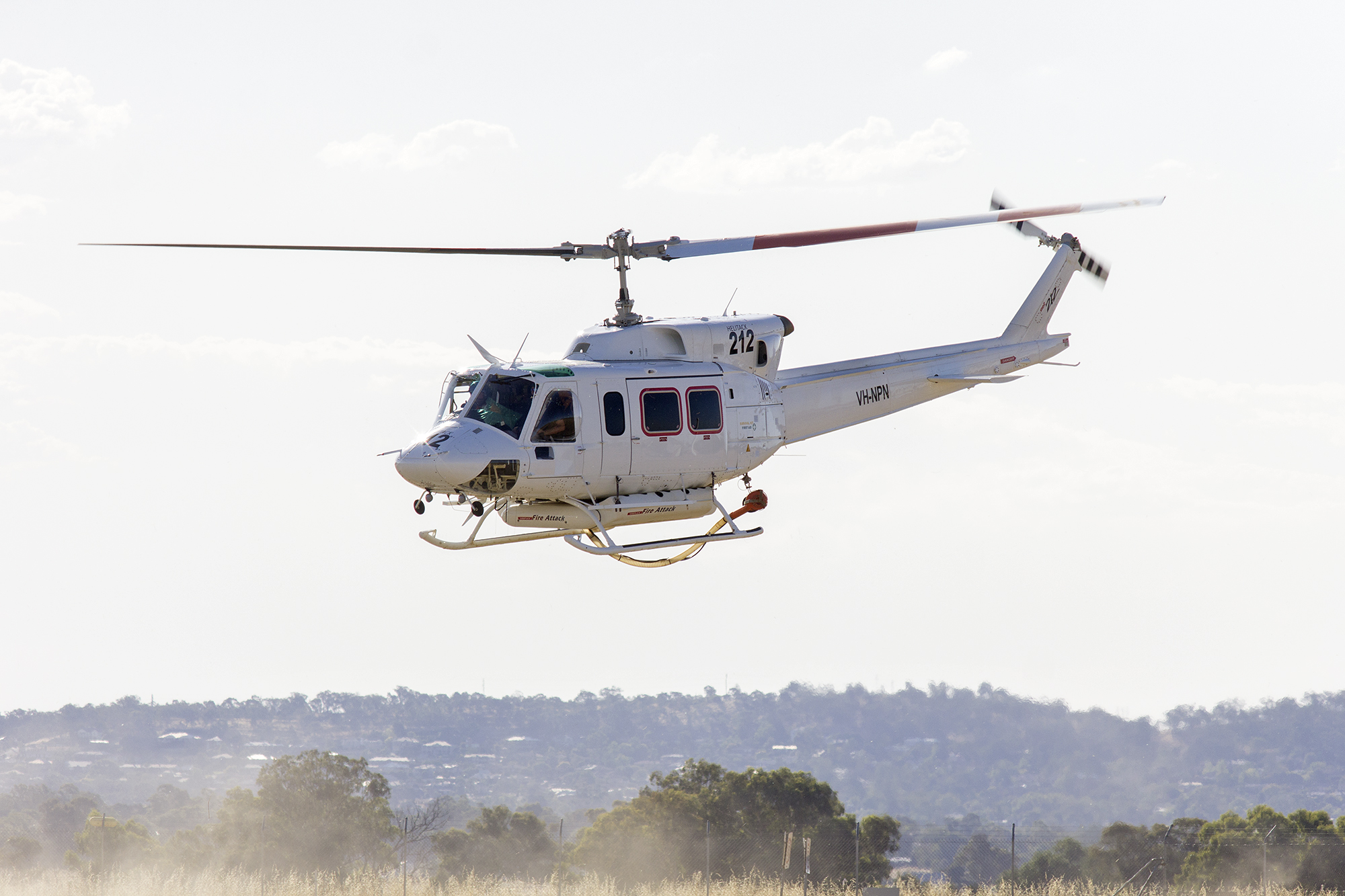 File:Commercial Helicopters (VH-NPN) Bell 212 departing Wagga Wagga Airport  (