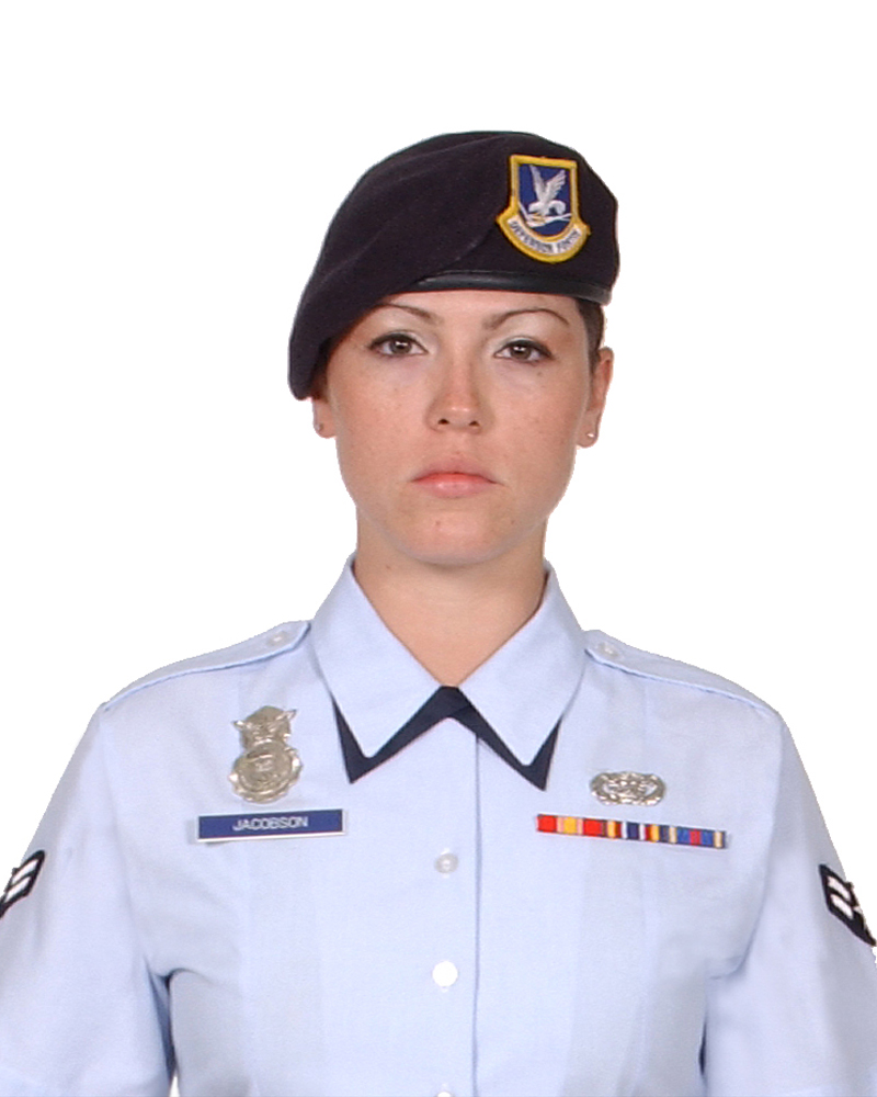 A woman wearing a black beret and a light blue shirt.