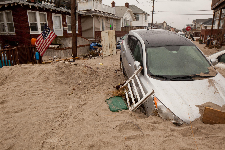 File:FEMA - 60742 - Cars buried in sand from Hurricane Sandy jpg