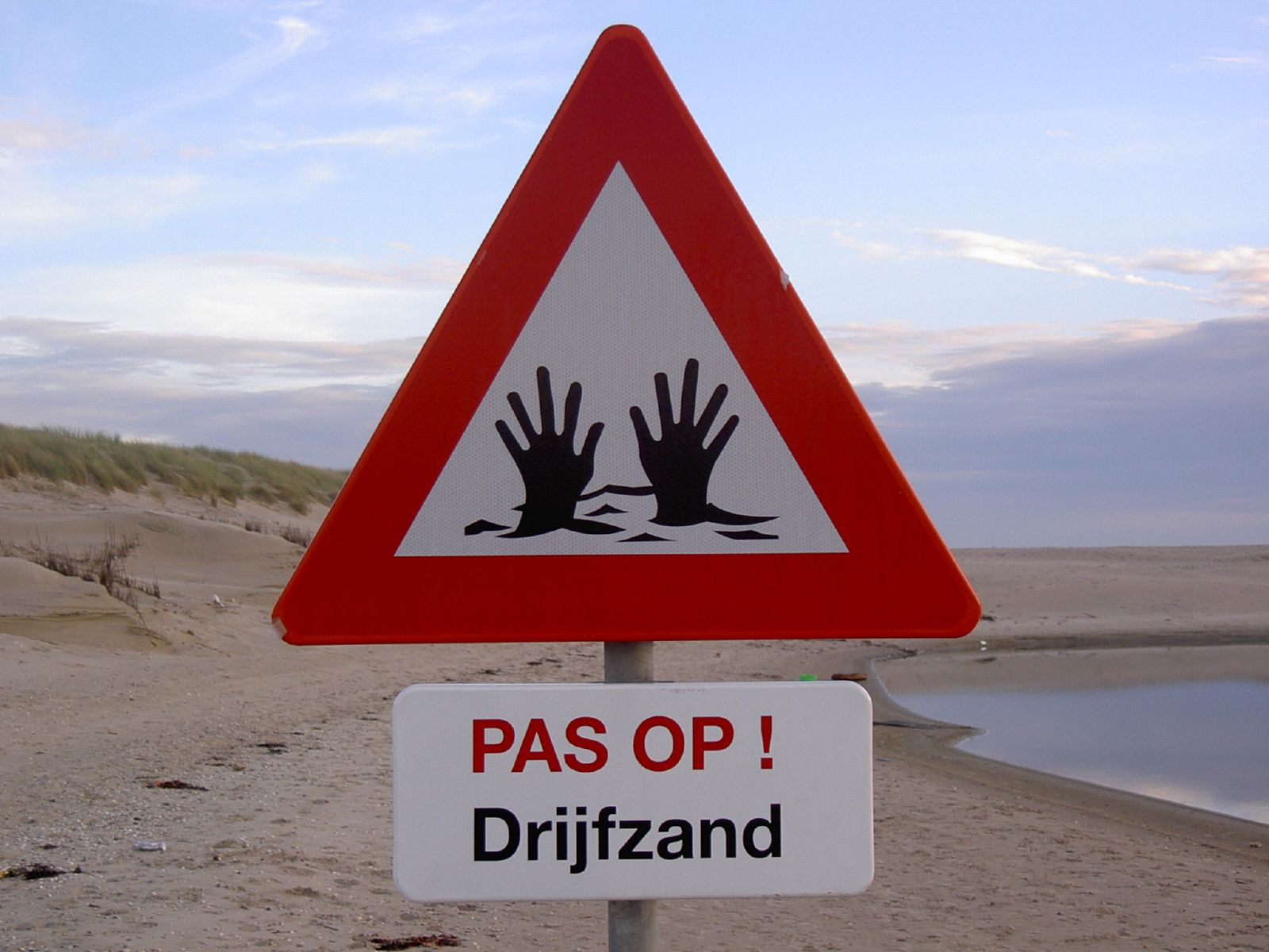 Caution - quicksand! sign in Dutch