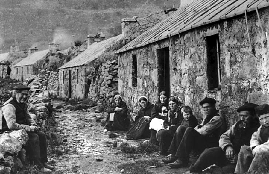 St. Kildans sitting in front of stone houses