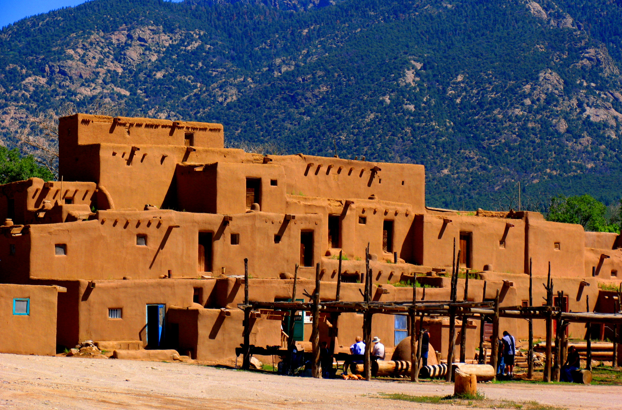 35 magical photos of taos pueblo new mexico places boomsbeat - Pueblo adobe houses property ...