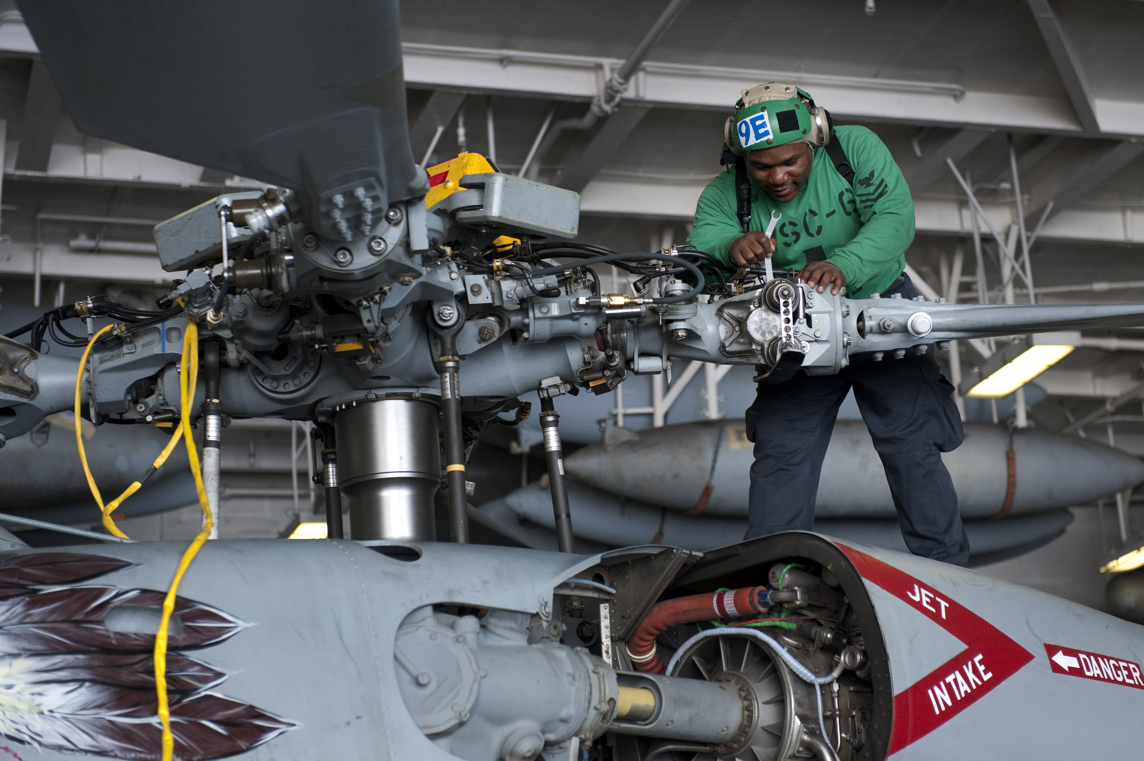 helicopter aircraft carrier with File U S  Navy Aviation Electrician's Mate 1st Class Eric Jones Performs Maintenance On An Mh 60s Seahawk Helicopter Assigned To Helicopter Sea  Bat Squadron  Hsc  6 In The Hangar Bay Of The Aircraft Carrier 130424 N Ks651 061 on UNIT BERBER CAVALRY besides 154kittyhawk furthermore File USS Carl Vinson  CVN 70  off Port Au Prince 17 Jan 2010 as well Holycityhelicopters further Stealth Ships.