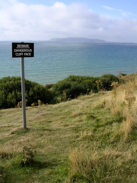 warning sign above Furzy Cliff