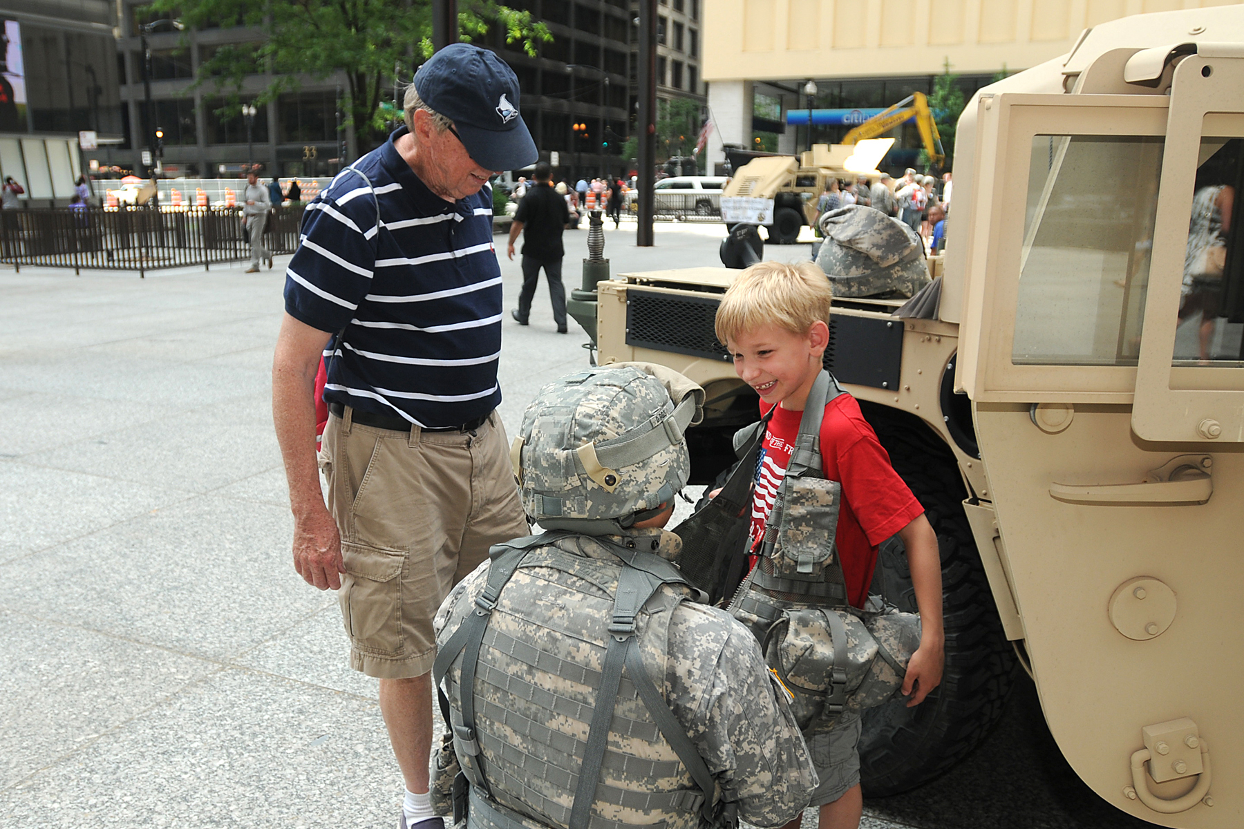 File:Army Reserve soldier gears up child for the Army's