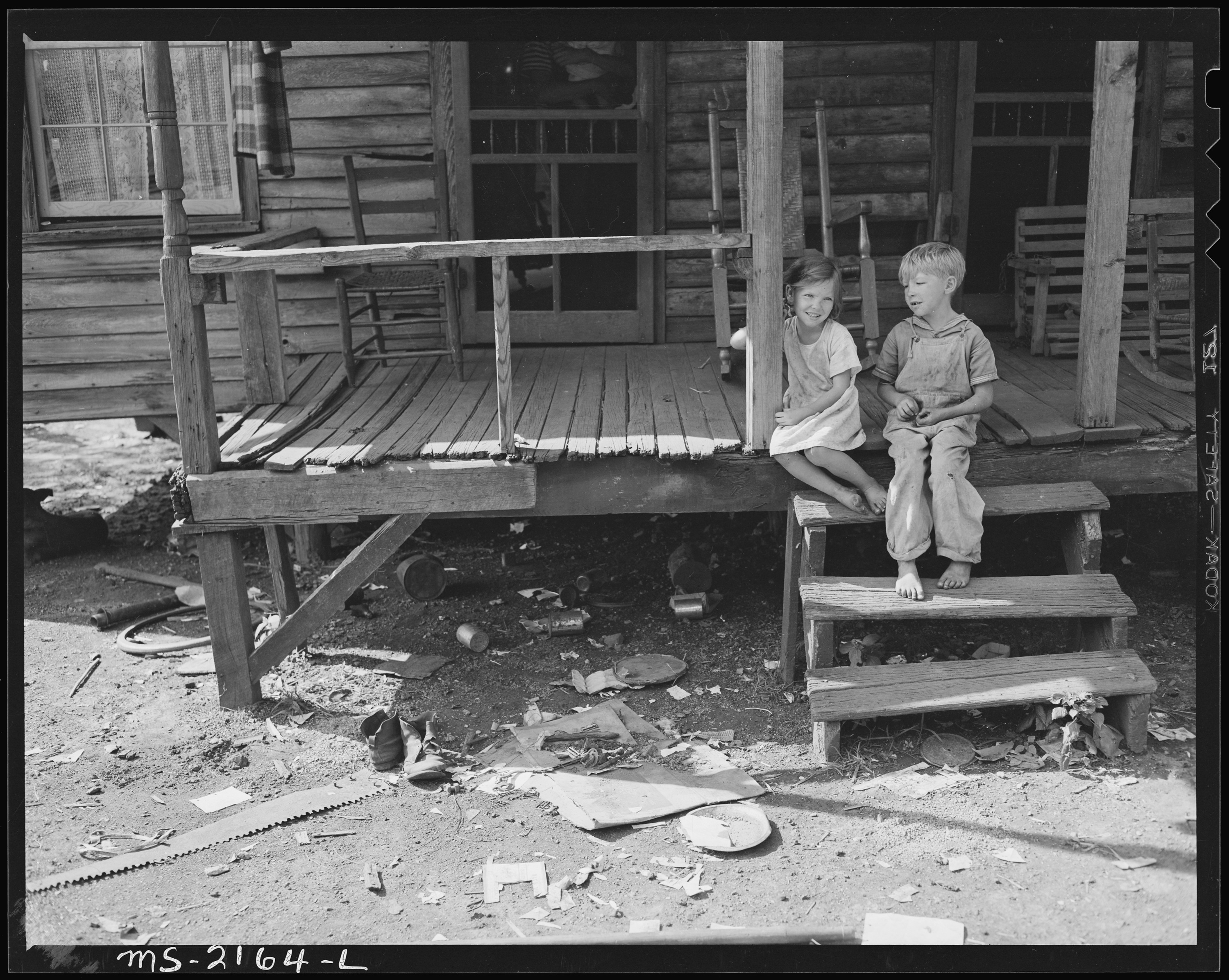 File Children Of A Miner On The Front Porch Of A Typical
