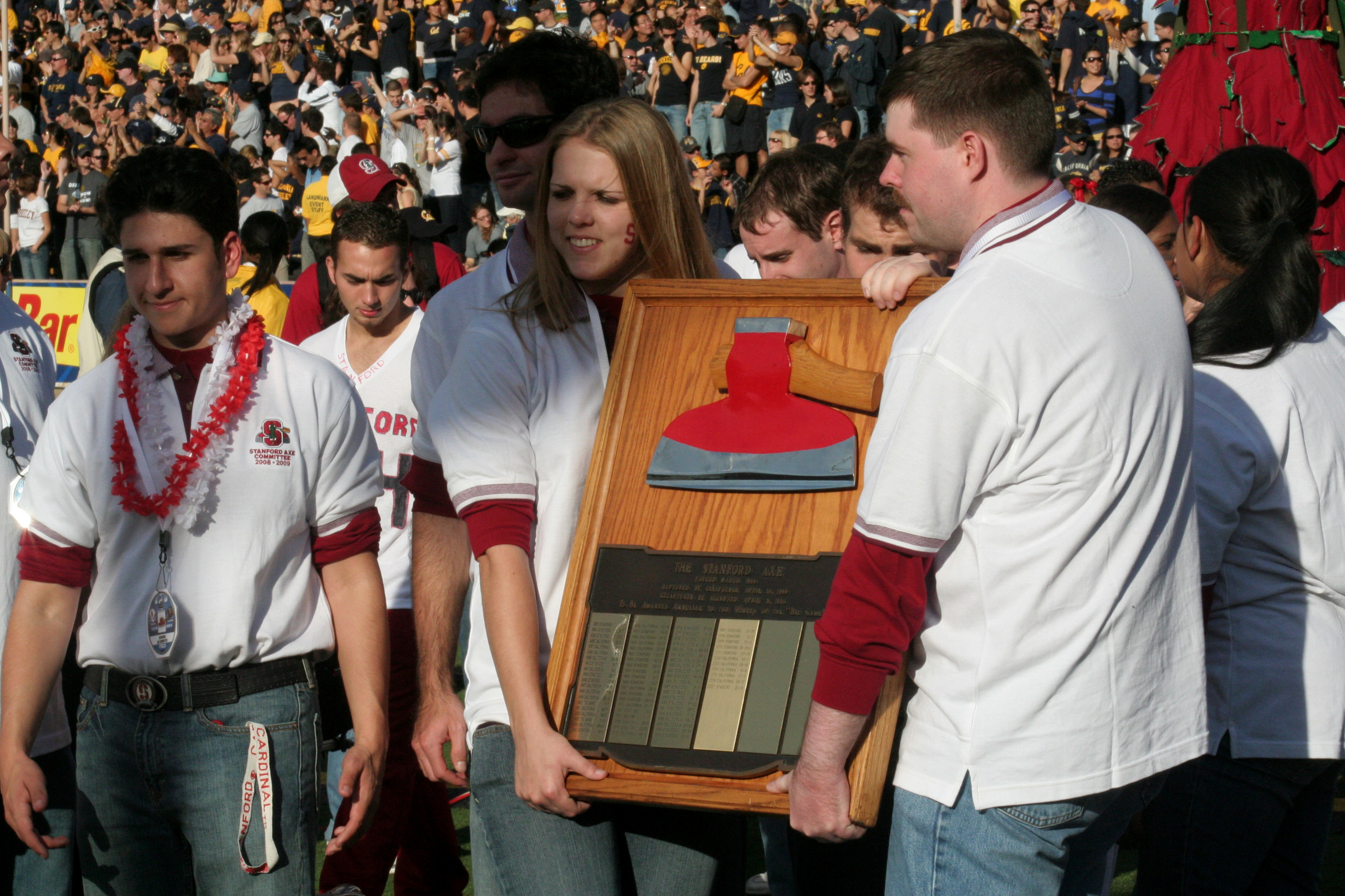 Stanford University's Axe Committee carries the Axe around Memorial Stadium.