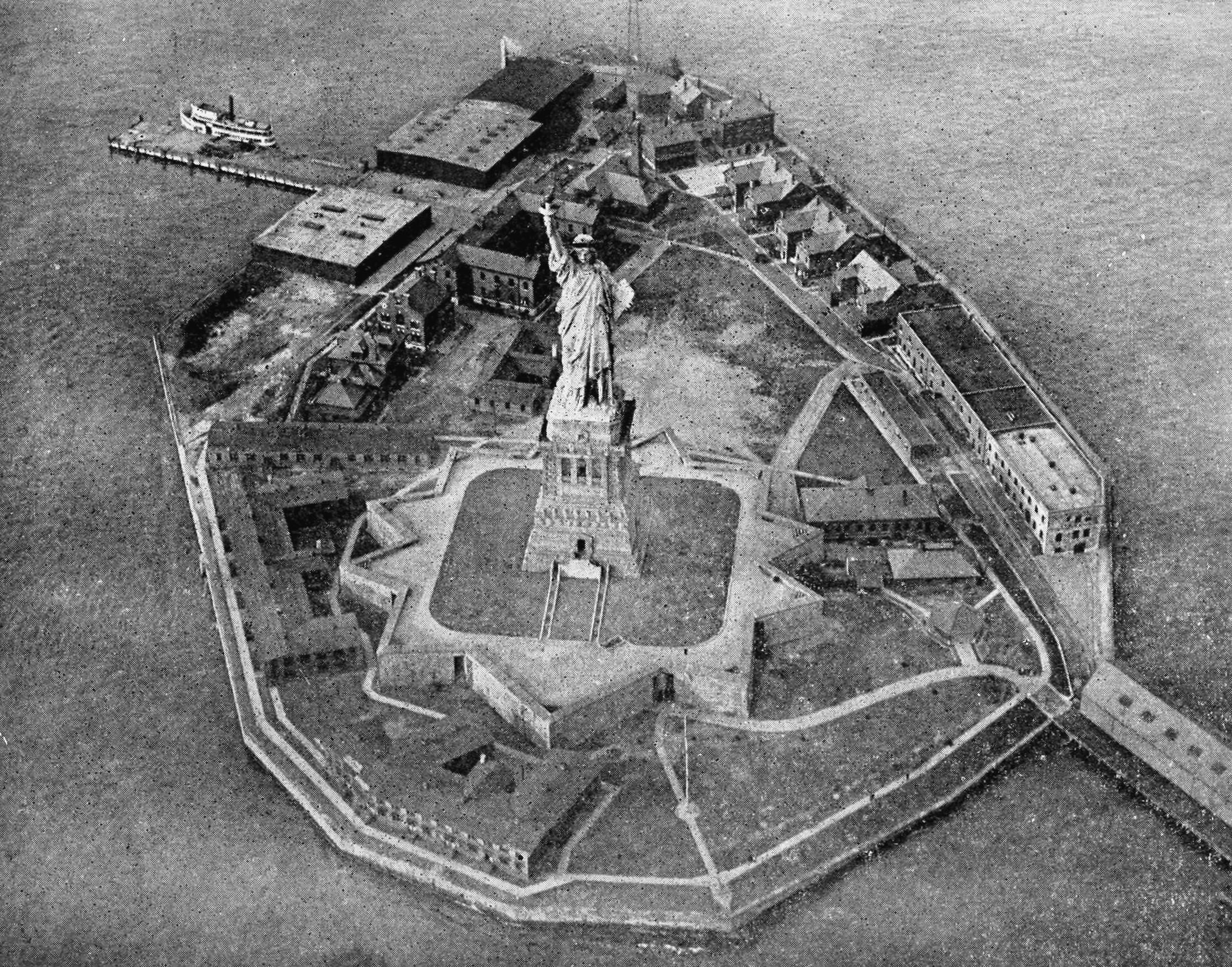 An aviator's photograph of the Statue of Liberty and Bedloe's Island, Harbor of New York, from Collier's New Encyclopedia