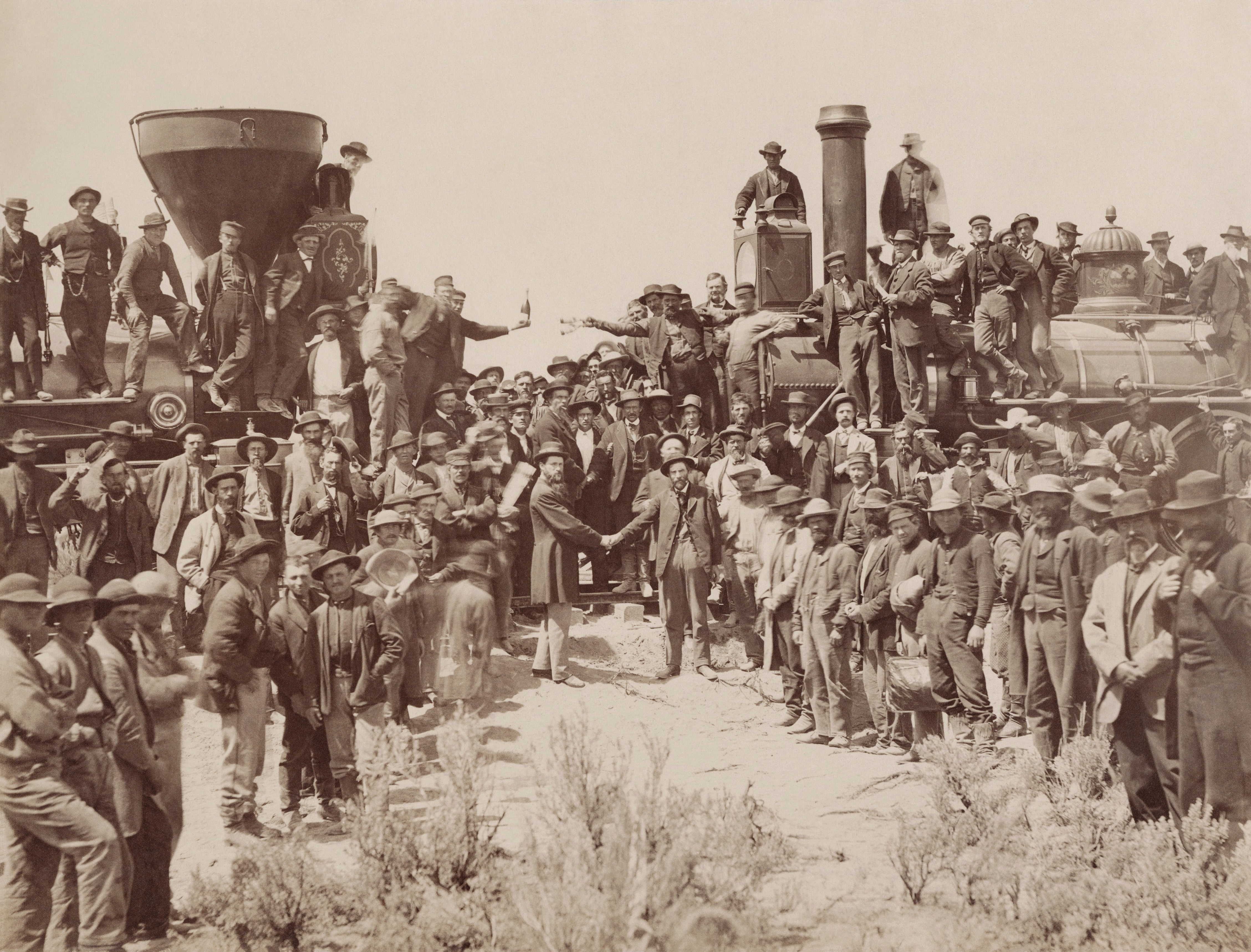 The ceremony for the driving of the golden spike at Promontory Summit, Utah on May 10, 1869; completion of the First Transcontinental Railroad