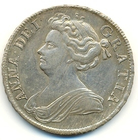 Half-crown coin of Queen Anne, 1708. The inscription reads in Latin: ANNA DEI GRATIA (Anne by the Grace of God).