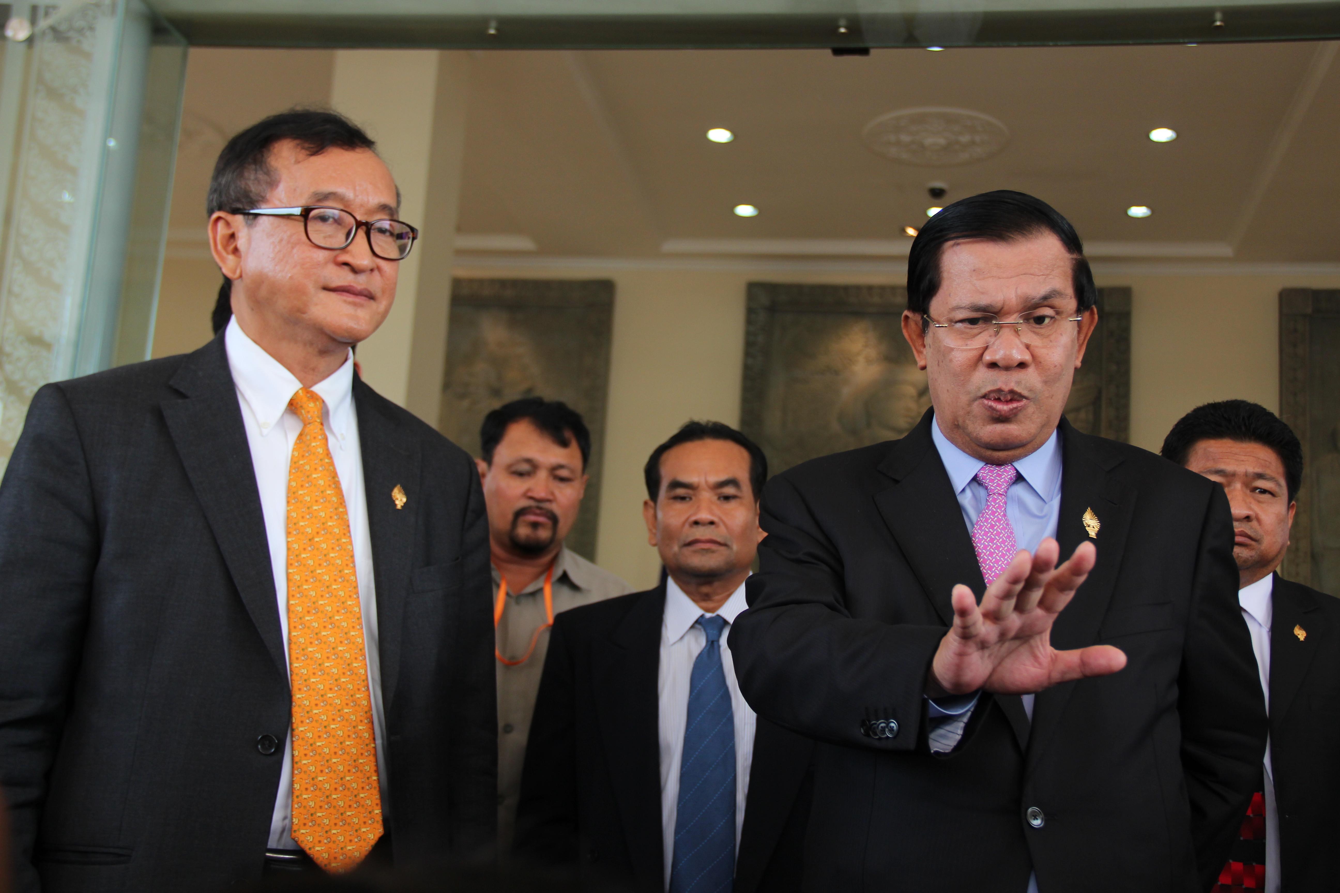 Opposition leader Sam Rainsy, left, and Cambodian Prime Minister Hun Sen