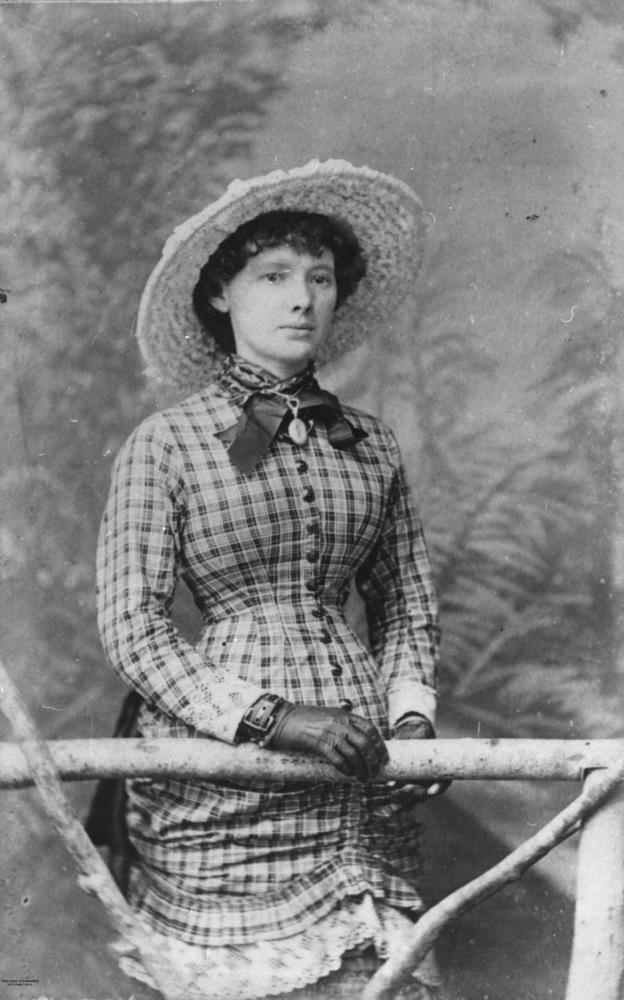 File:StateLibQld 1 68995 Young woman wearing a checked ...
