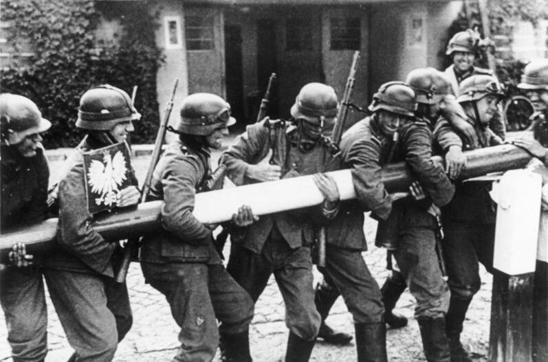 German soldiers remove a frontier bar