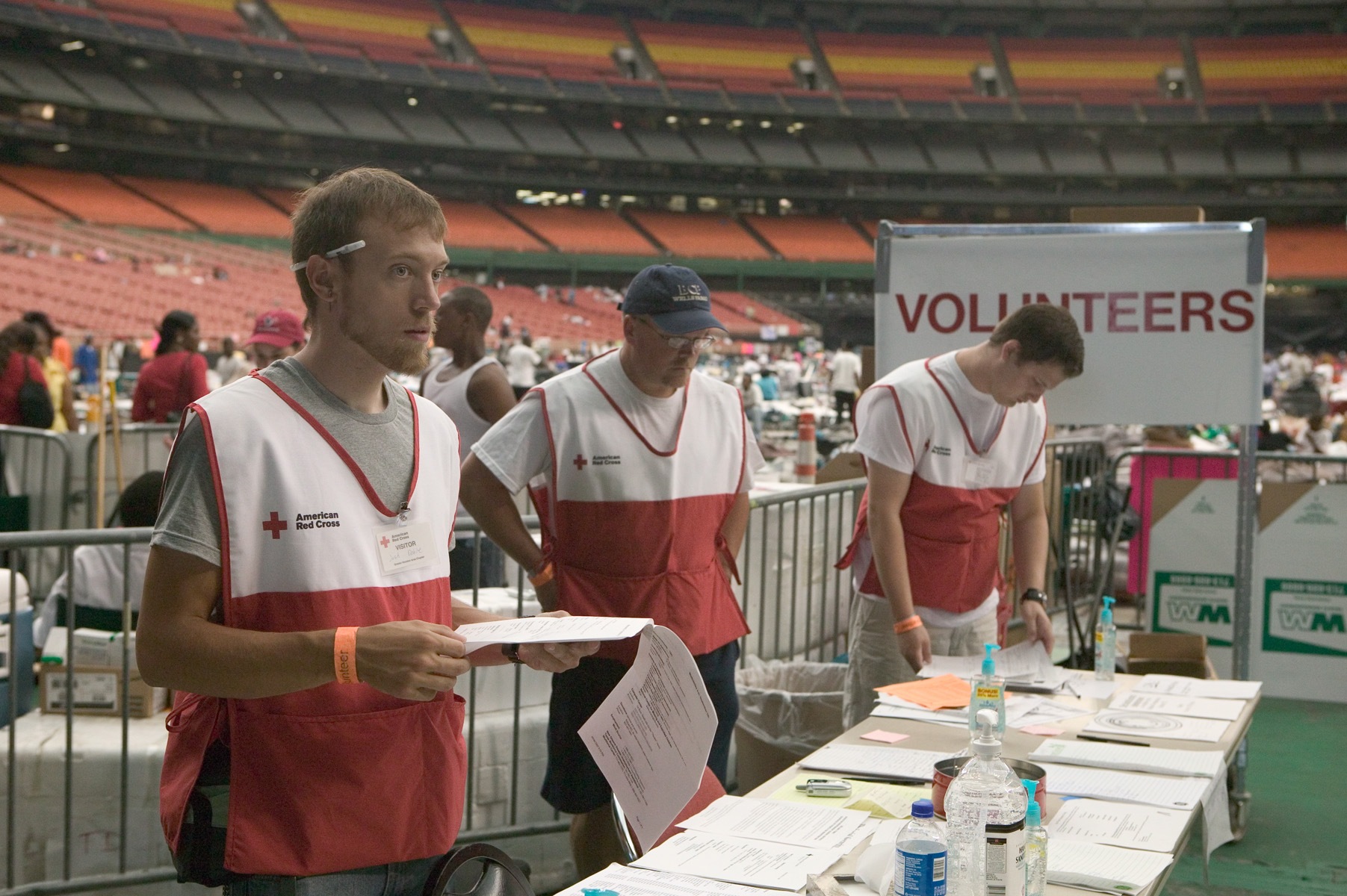 Volunteers assist Hurricane victims at the Houston Astrodome, following Hurricane Katrina.