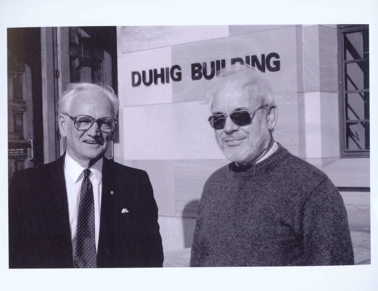 Former University Librarian Harrison Bryan with University Librarian Derek Fielding outside the Duhig Building at the University of Queensland, Brisbane, 20 Jul 1992. Used with the permission of Fryer Library University of Queensland Photograph Collection, UQFL466, AG/P/112.
