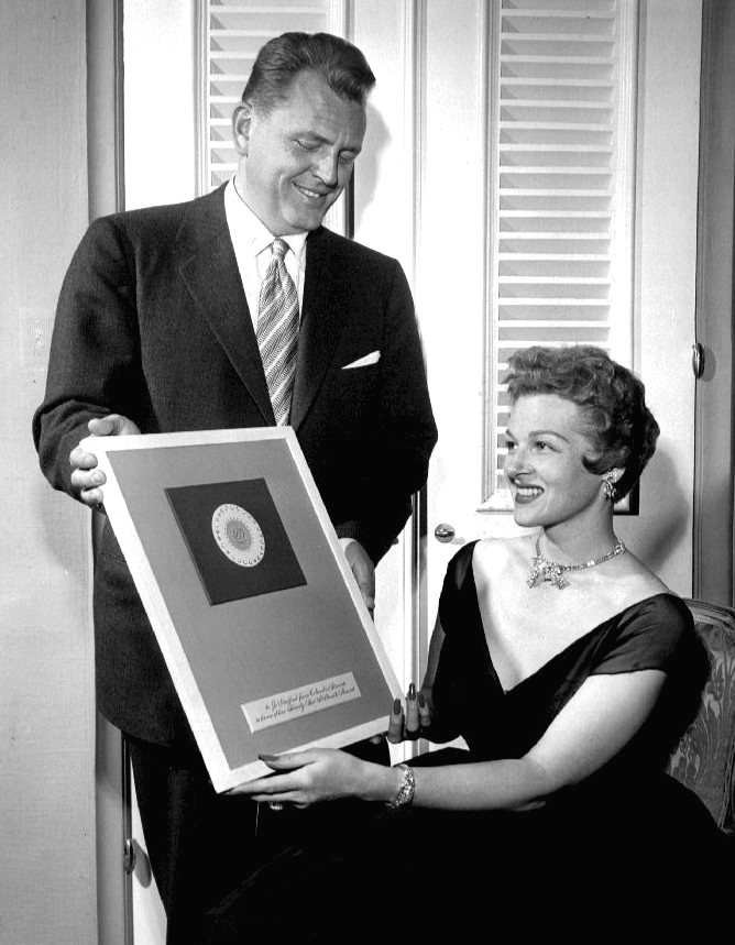 http://upload.wikimedia.org/wikipedia/commons/a/aa/Jo_Stafford_25_million_records_sold_diamond_award_1954.jpg
