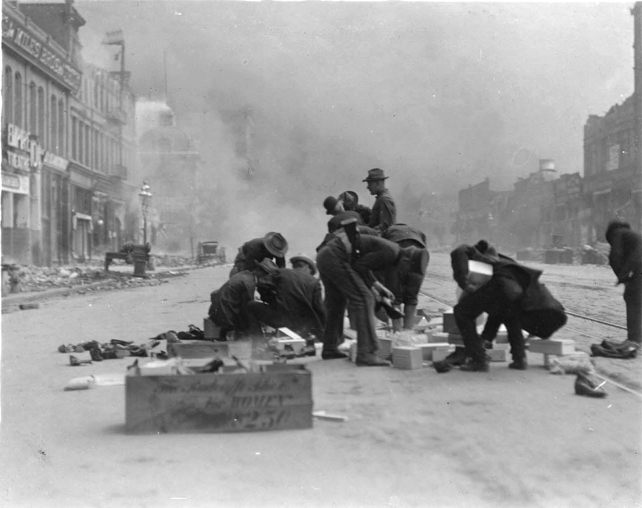 Soldiers of the 22nd Infantry Regiment looting after the 1906 San Francisco earthquake and fire, 1906.