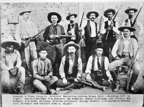 Caption: Company D, Texas Rangers, Frontier Battalion, Ysleta, Texas, 1894 --- Reading left to right [standing]: Dep. U.S. Marshal F.M. McMahon; Vn. Schmidt; James V. Latham; Joe Sitter; Ed Palmer; T.T. Cook; Sitting: Mexican prisoner; George Tucker; J.W. Saunders; Seargt. Carl Kirchner and Captain John R. Hughes.