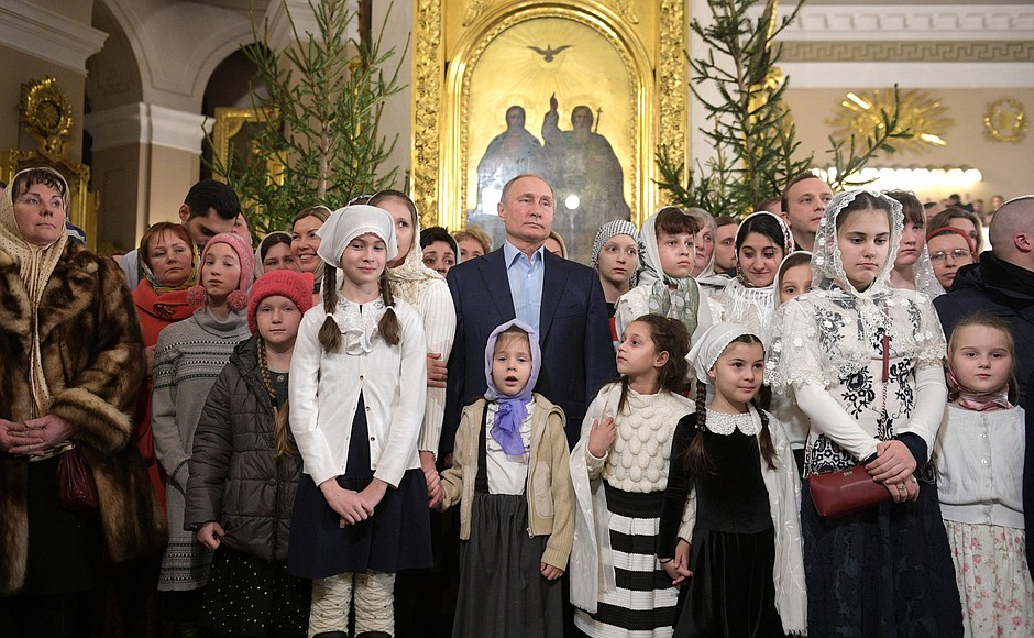 Vladimir Putin celebrates Christmas with orthodox Christians in St Petersburg (2019-01-07) 5.jpg
