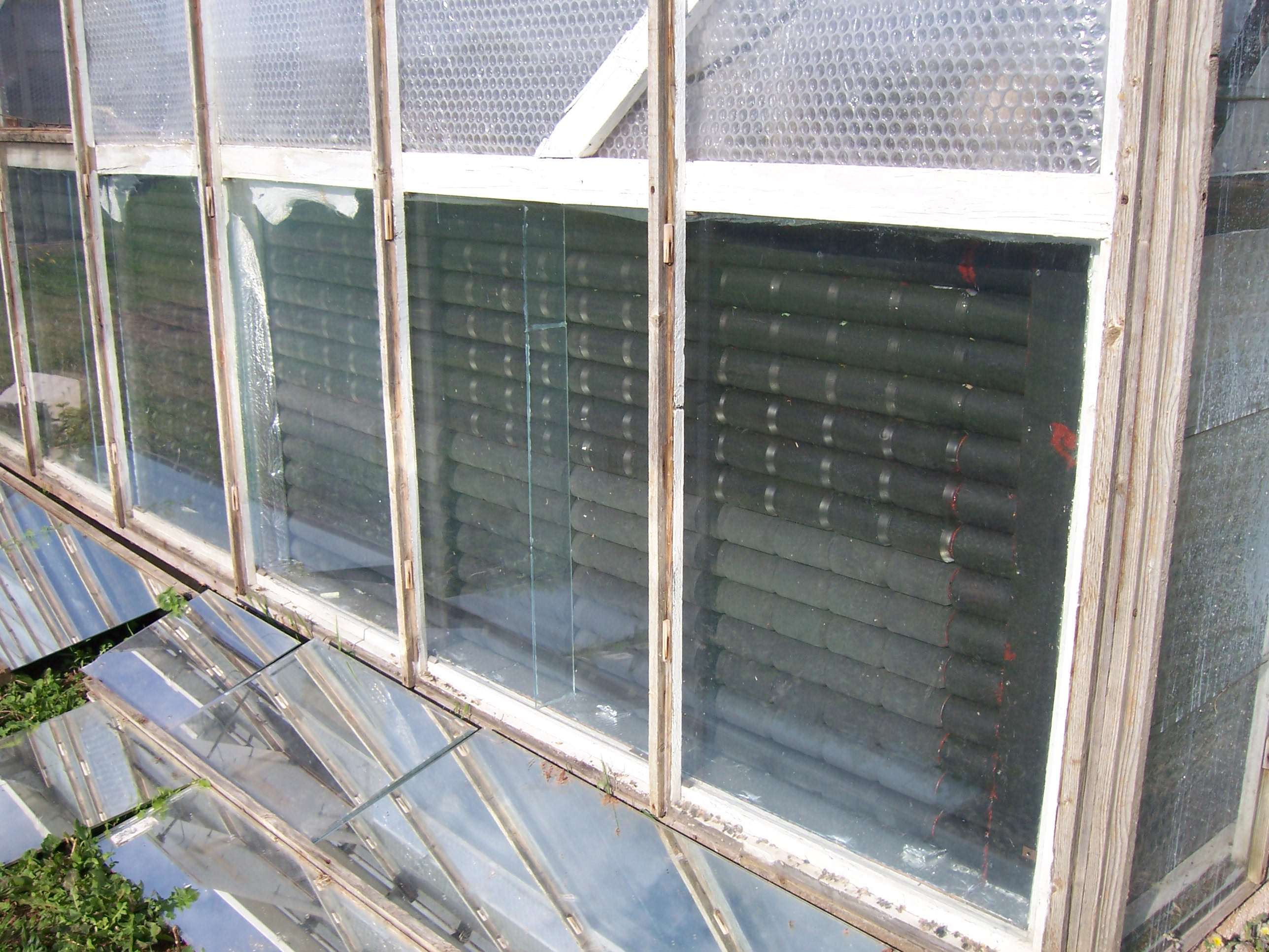 File A Solar Greenhouse Heater Made Of Pop Cans