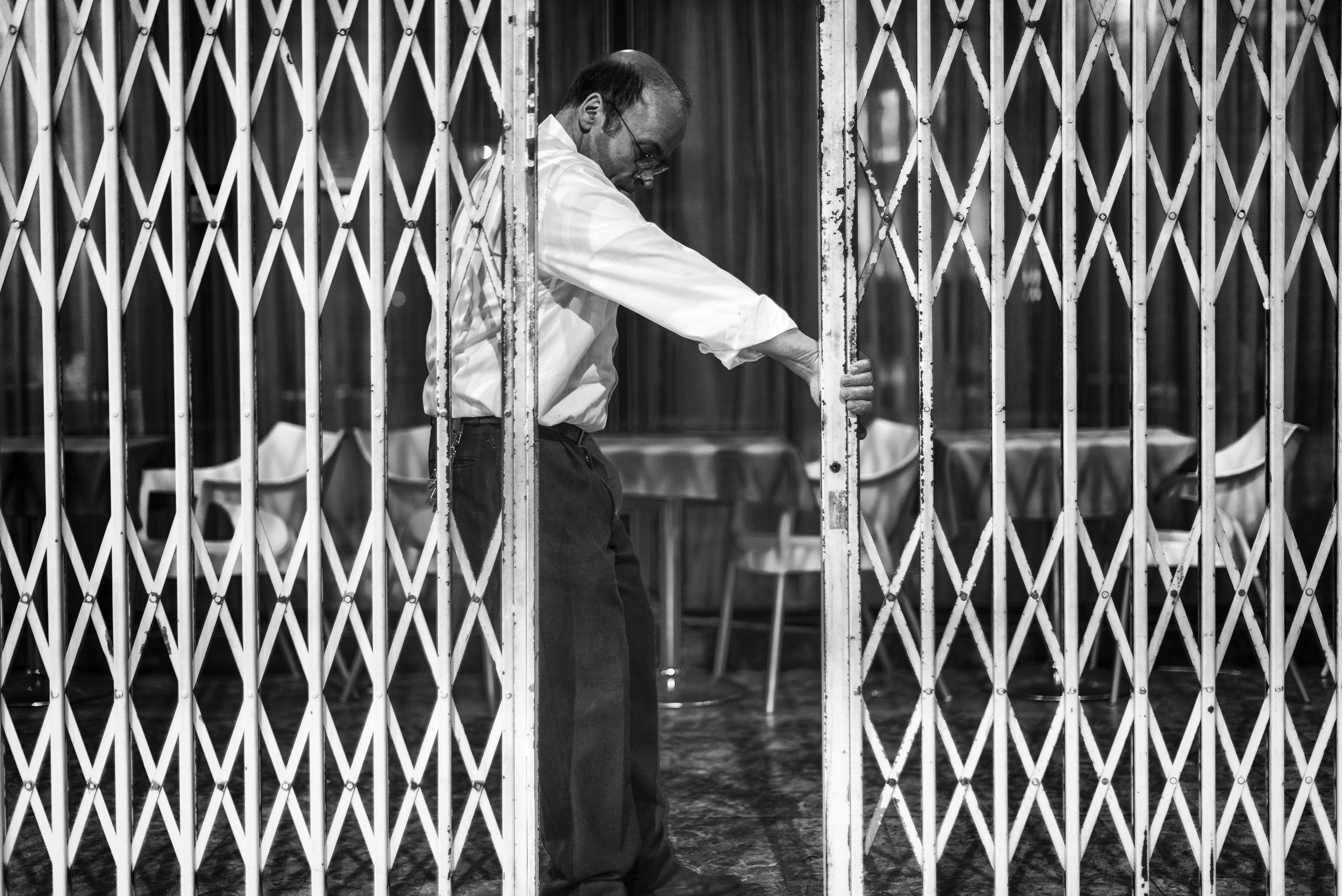 A gatekeeper closing the gate
