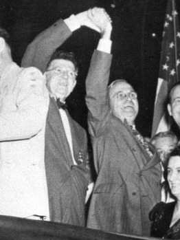Chicago mayor Edward J. Kelly holds up Truman's arm in a  celebratory gesture