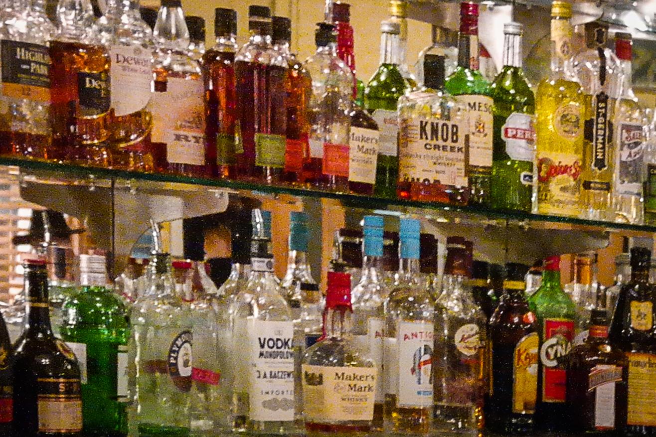 File Two Shelves Full Of Liquor Bottles Portland Oregon