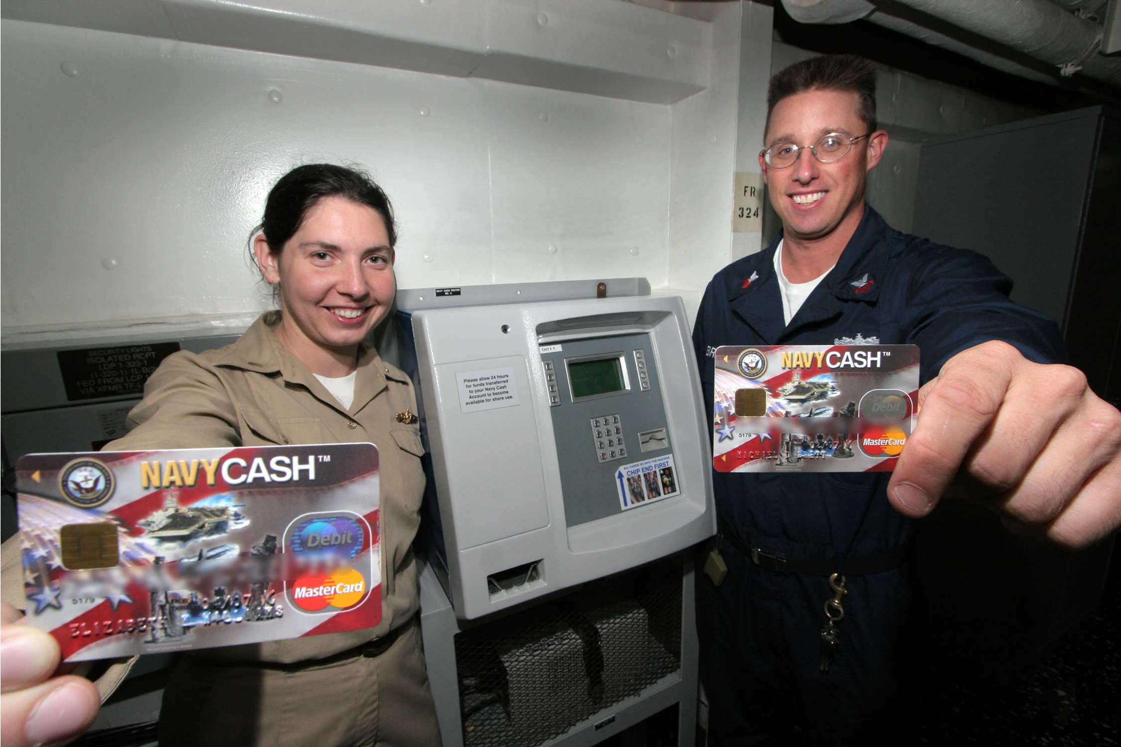 What is Navy Cash? The Navy Cash card is a branded debit card that looks like a typical debit or check card. Navy Cash combines a chip-based electronic purse (stored-value function) with the traditional magnetic stripe (debit card and ATM function). The electronic purse replaces currency aboard ship.