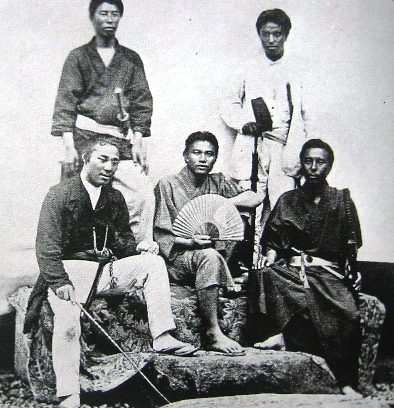 Officers of the Japanese warship Kasuga in August 1869. Third-class officer Togo is dressed in white, top right. Haruhi(Officers).JPG