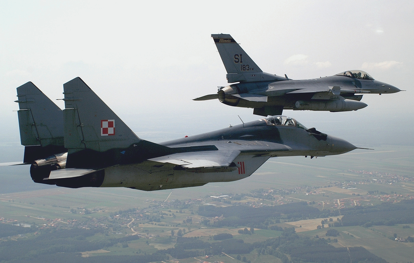 http://upload.wikimedia.org/wikipedia/commons/a/ac/U.S._F-16C_Fighting_Falcon_and_Polish_Mikoyan-Gurevich_MiG-29A_over_Krzesiny_air_base%2C_Poland_-_20050615.jpg