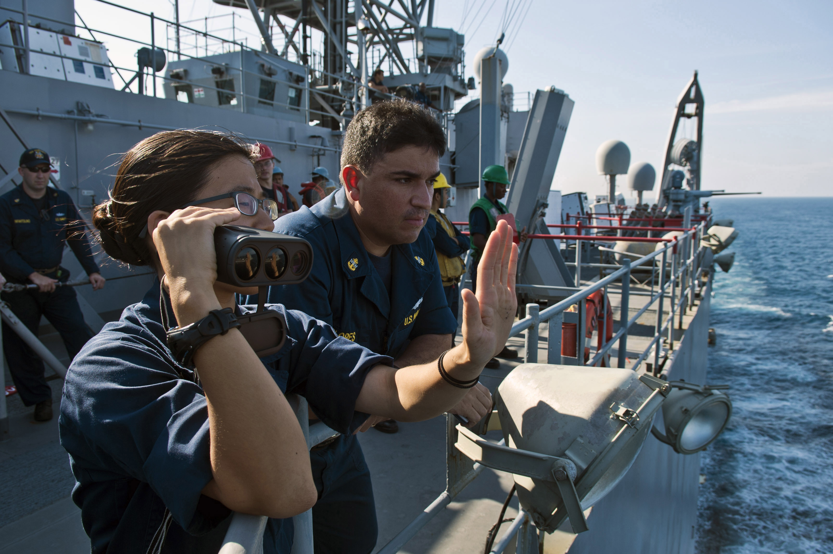 U.S. Navy Ensign Kristine Mun, left foreground, and Chief ...