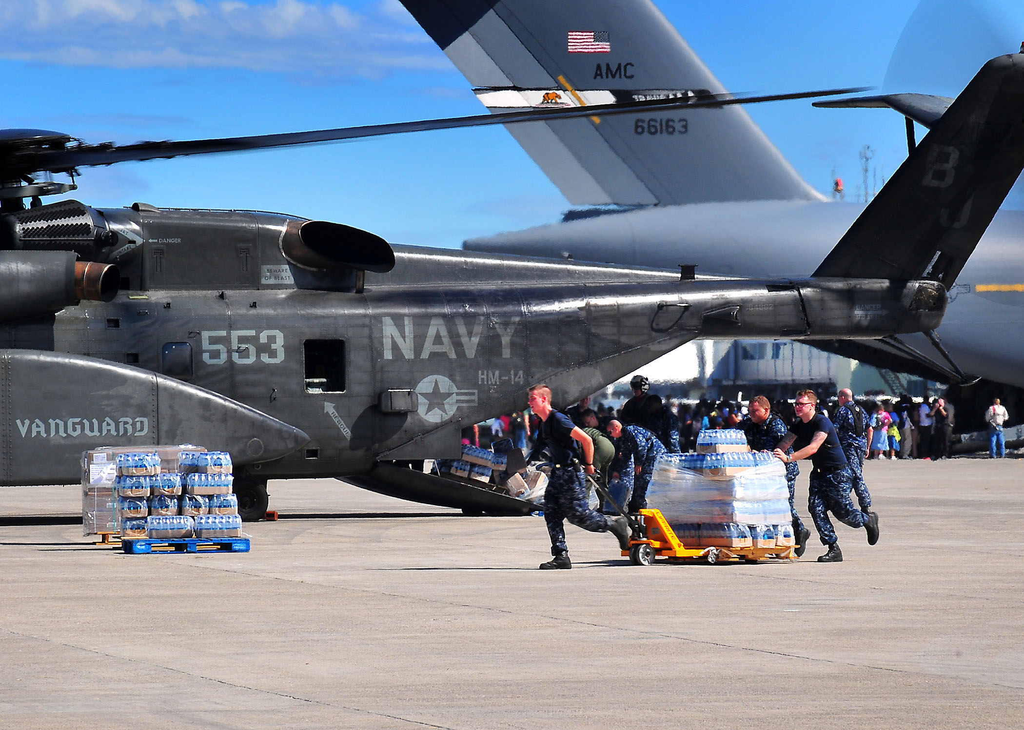 File:US Navy 100116-N-4774B-827 Sailors load bottles of fresh