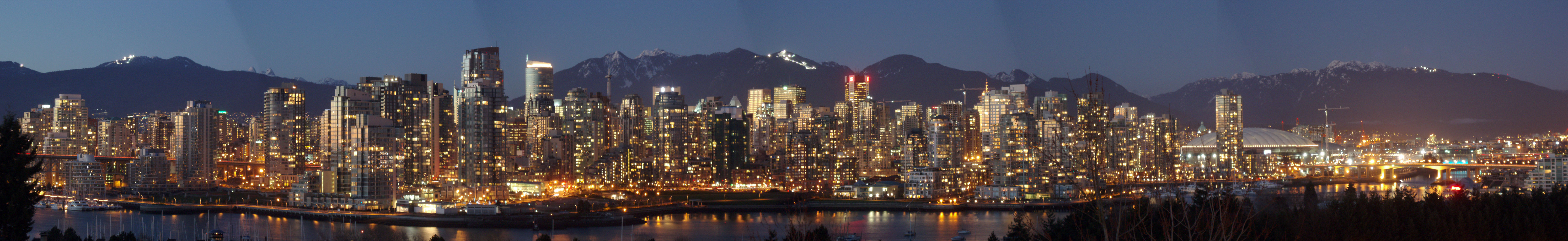 Panorama of Vancouver skyline at night.