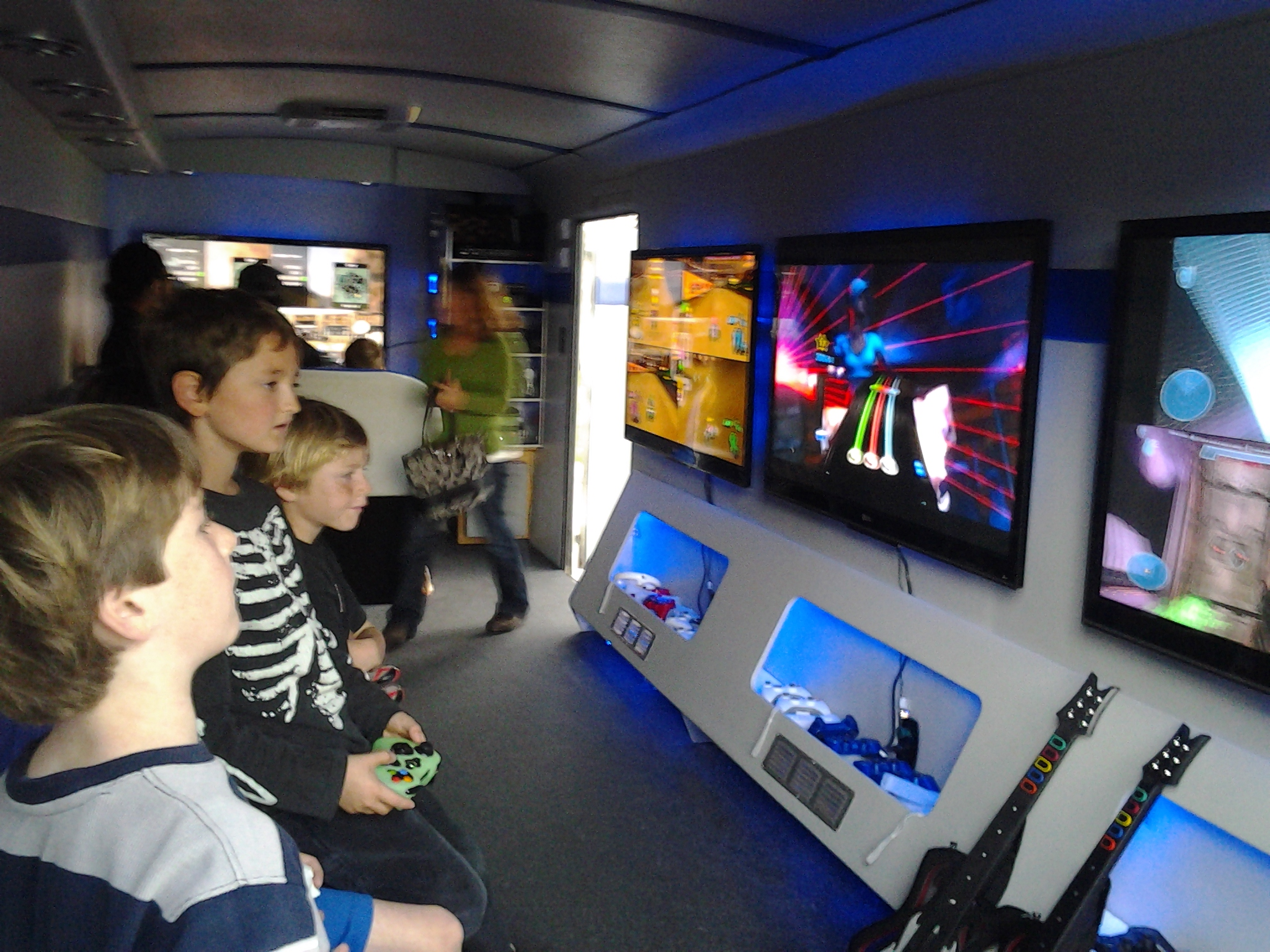 Children playing video games & TV's.jpg