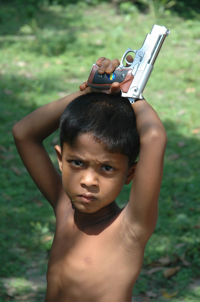 File:Little boy with toy gun jpg - Wikimedia Commons