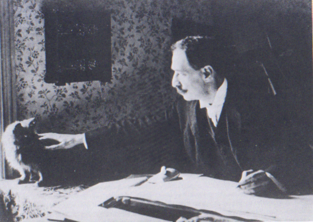 Ficheiro:Louis Wain at his drawing table 1890.png