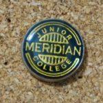 Old collar pin of Meridian Junior College.