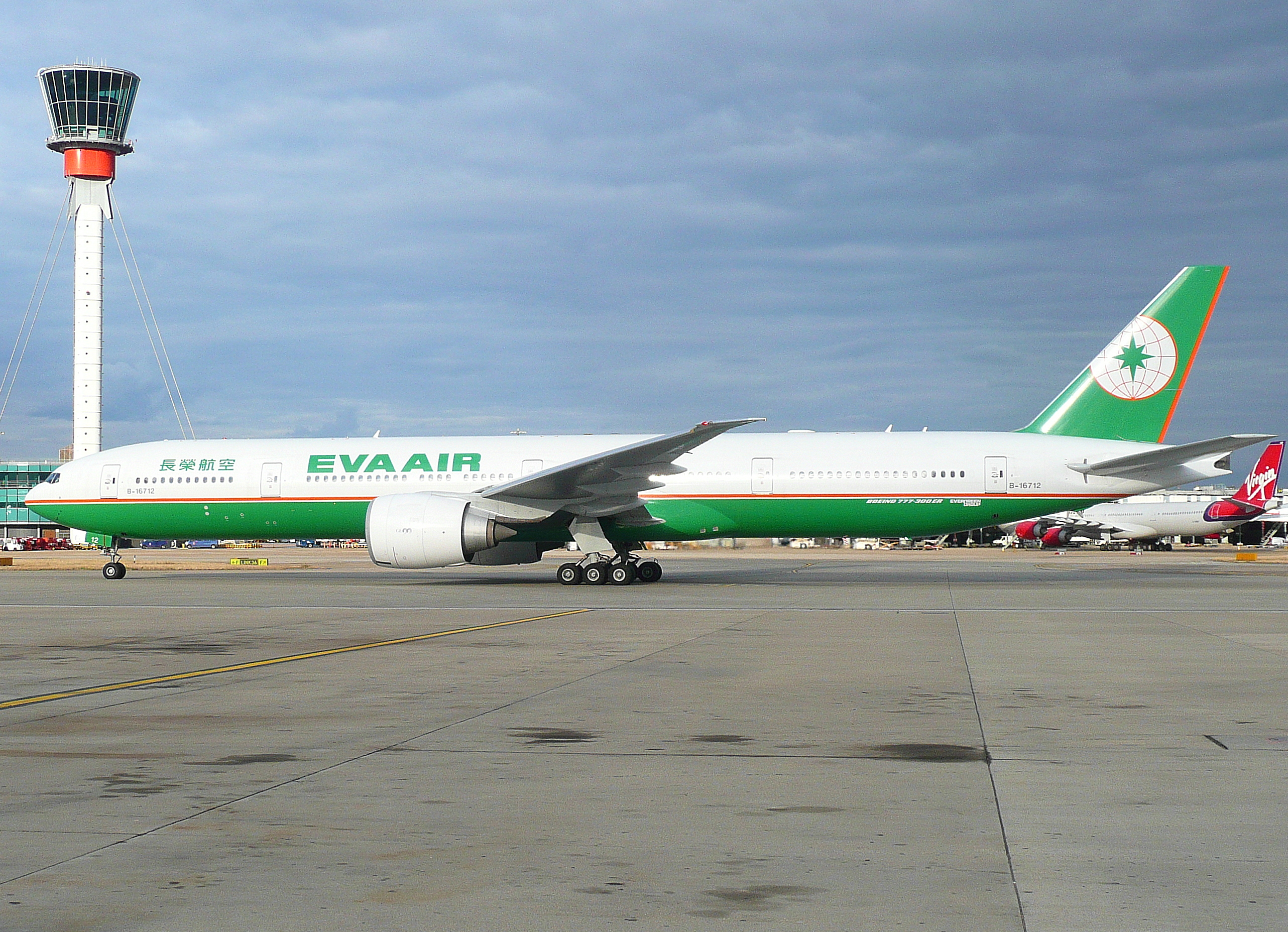 File:B-16712 B773 Eva Air passing the control tower (4867843393).