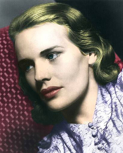 Color photo of a blonde-haired woman against a speckled red background